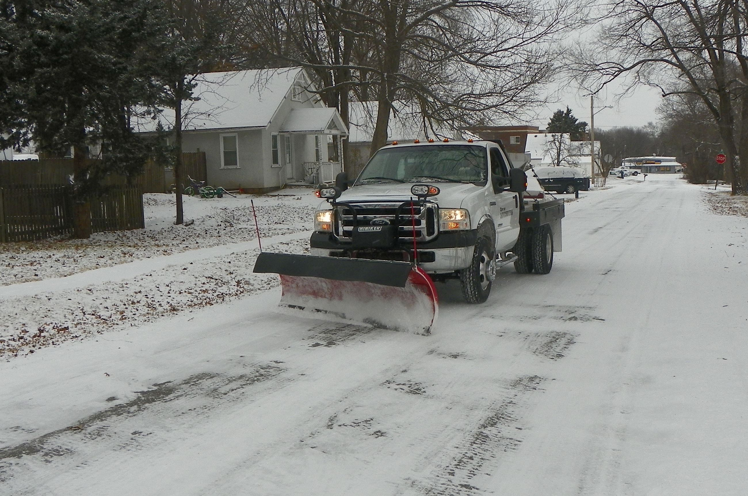 Louisburg city crews remove snow on city streets.